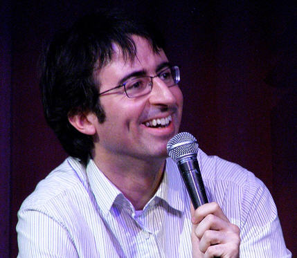John Oliver, facing right