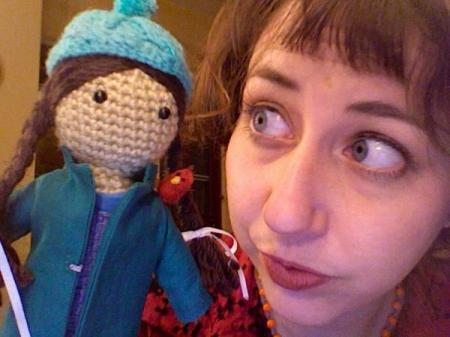 Kristen Schaal with doll